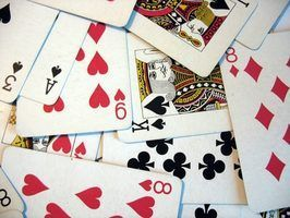 Jeux de cartes à jouer avec des quartiers